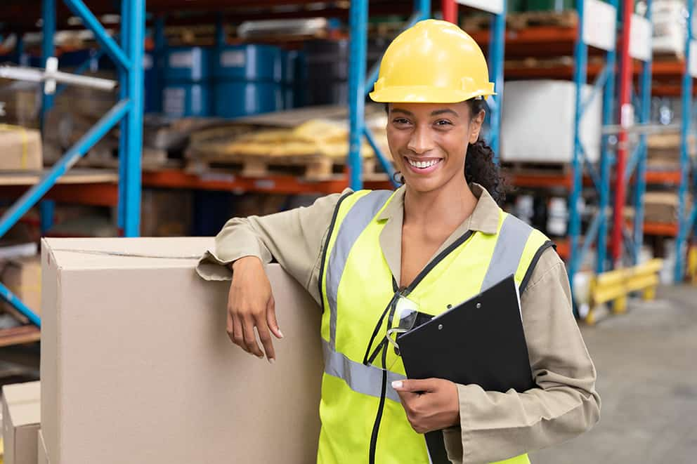 Female Logistics Worker in embroidered HiVis in a warehouse in birmingham