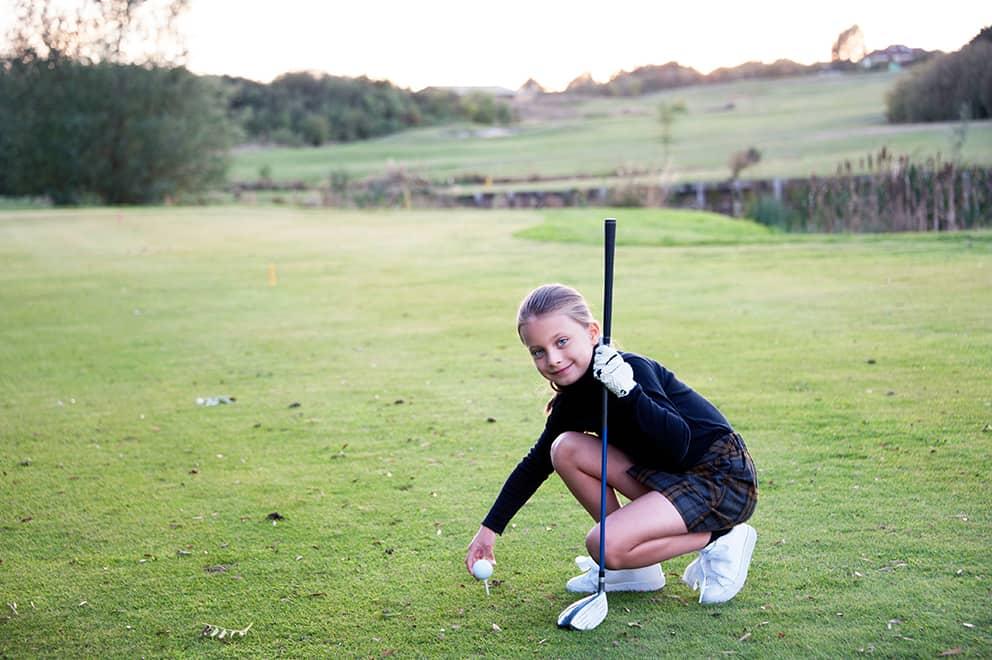 Junior Golfer wearing a personalised golf shirt